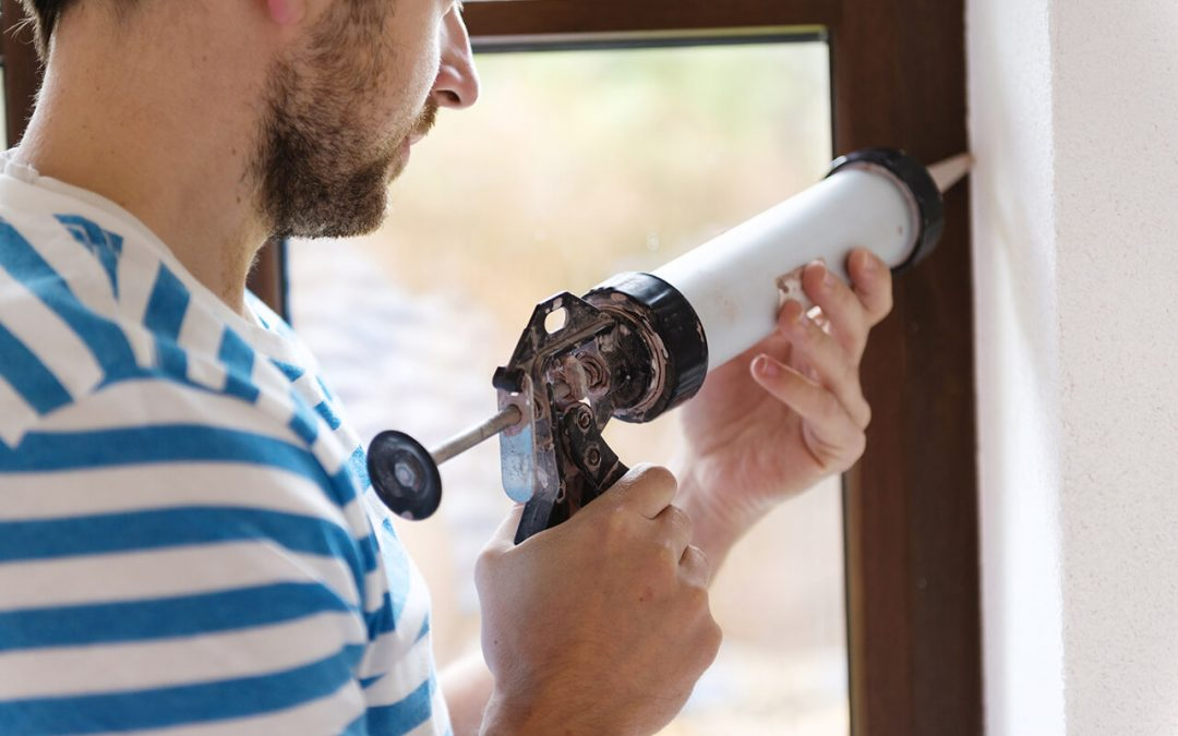 reduce winter heating costs by re-caulking windows